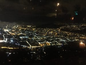 City lights of Quito, Ecuador seen from above at night.