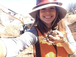 Kathlyn Franco holding a frog in the sunlight